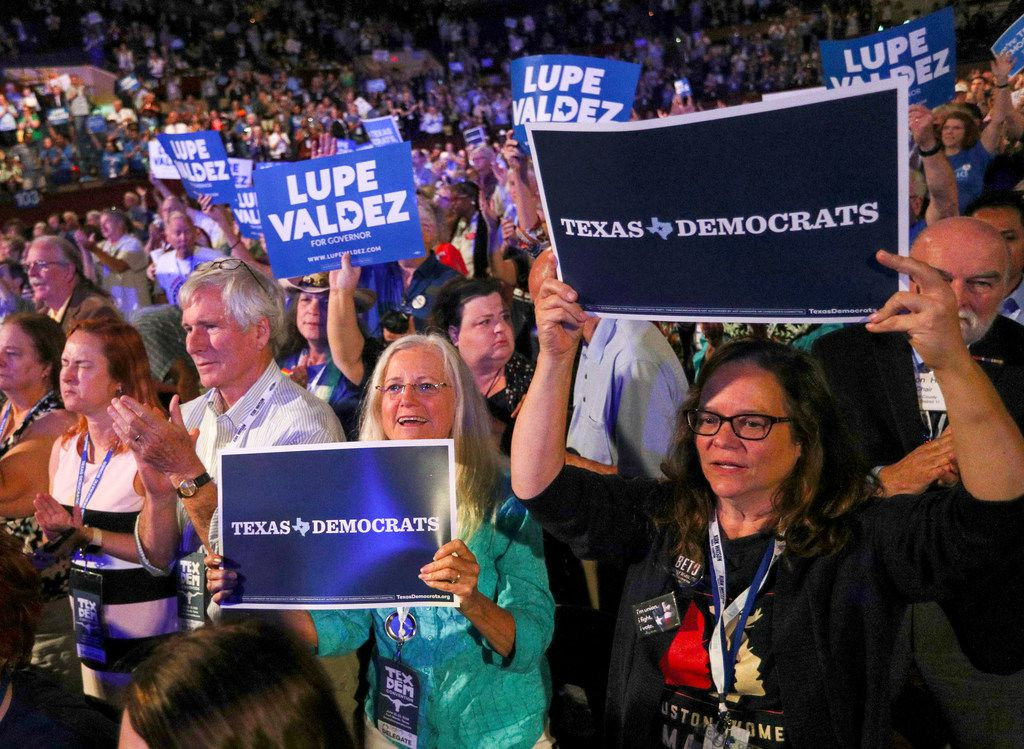 Attendees cheer and wave signs during the speech by Texas gubernatorial candidate Lupe Valdez at the Texas Democratic Convention Friday, June 22, 2018, in Fort Worth, Texas. (AP Photo/Richard W. Rodriguez)