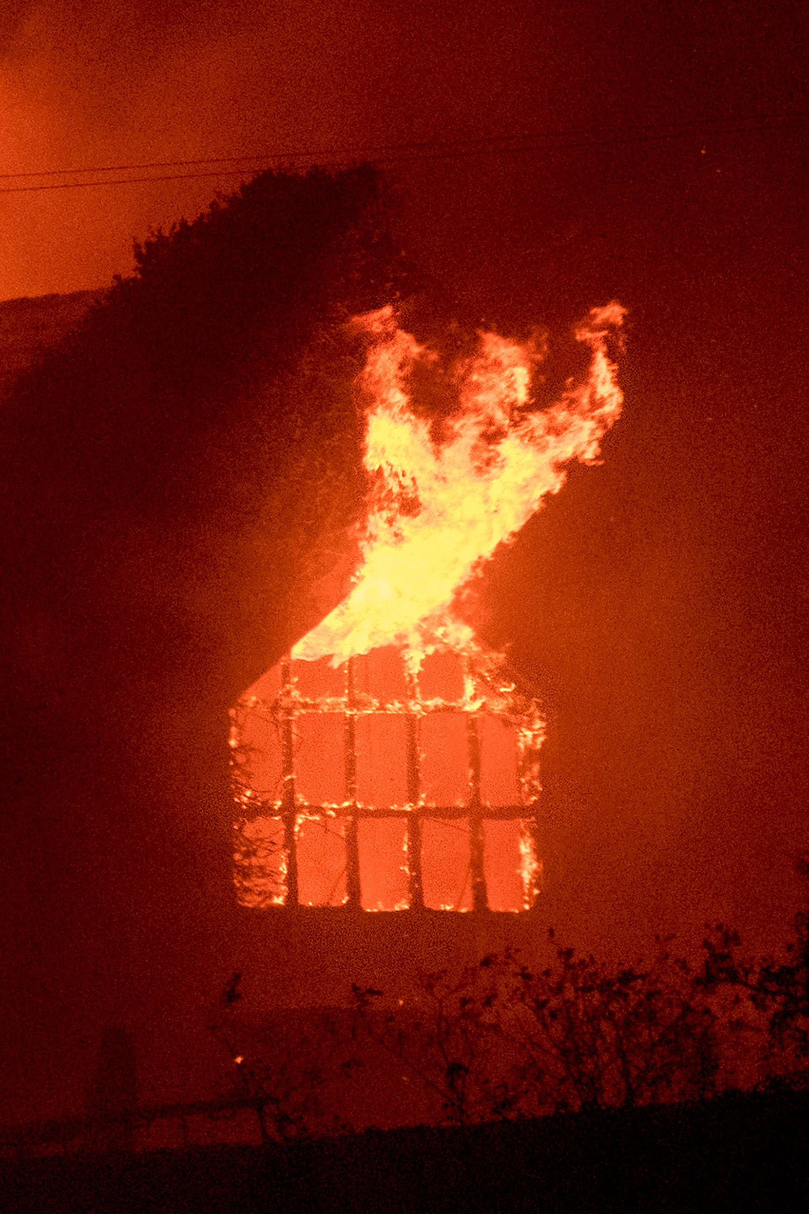 Flames shoot out from a window as the Signorello Estate winery burns in the Napa wine region of California on October 9, 2017.