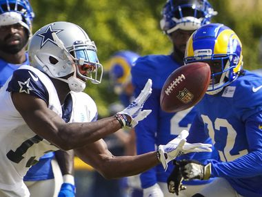 Dallas Cowboys wide receiver Michael Gallup (13) catches a long pass as Los Angeles Rams defensive back David Long (22) defends during a joint practice at training camp on Saturday, Aug. 7, 2021, in Oxnard, Calif.