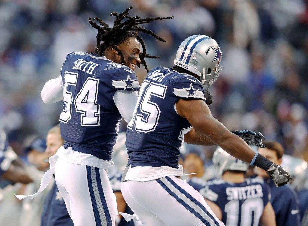 Dallas Cowboys outside linebacker Jaylon Smith (54) and Dallas Cowboys running back Rod Smith (45) celebrate after Rod Smith scored his second touchdown of the night during the second half of play at MetLife Stadium in East Rutherford, New Jersey, on Sunday, December 10, 2017. Dallas Cowboys defeated the New York Giants 30-10. (Vernon Bryant/The Dallas Morning News)