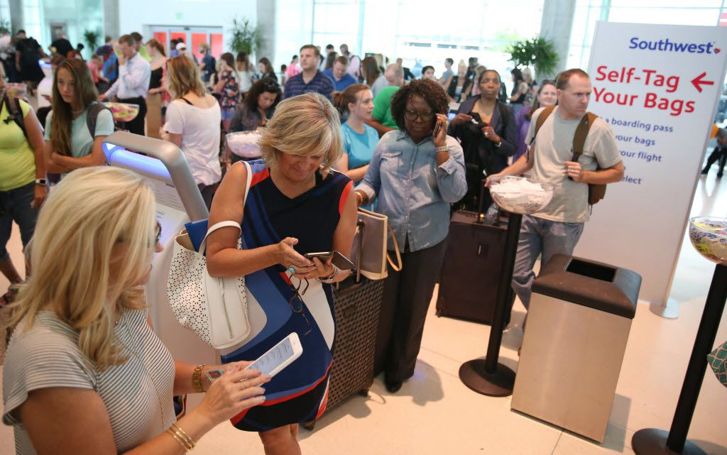 Passengers waited in line at the Southwest Airlines terminal at Dallas Love Field in July. Technical issues disrupted the carrier's operations systemwide, including Love Field, grounding flights and causing long lines at airports across the country. (Rose Baca/Staff Photographer)