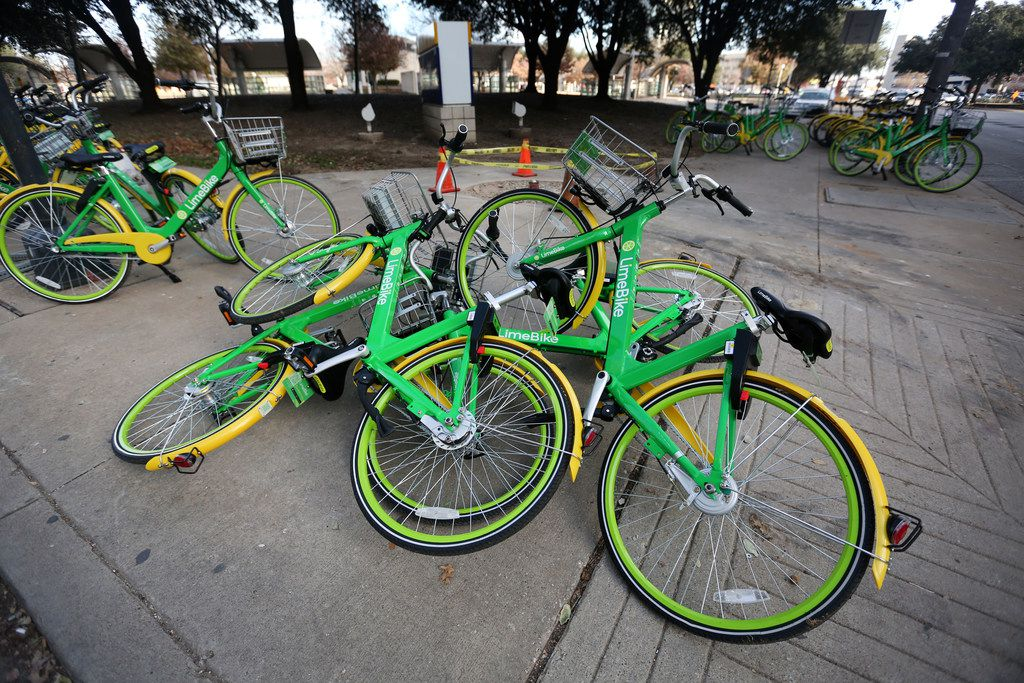 Rental bikes are piled on the corner of Live Oak and Olive Streets in downtown Dallas on Thursday, Jan. 4, 2018.