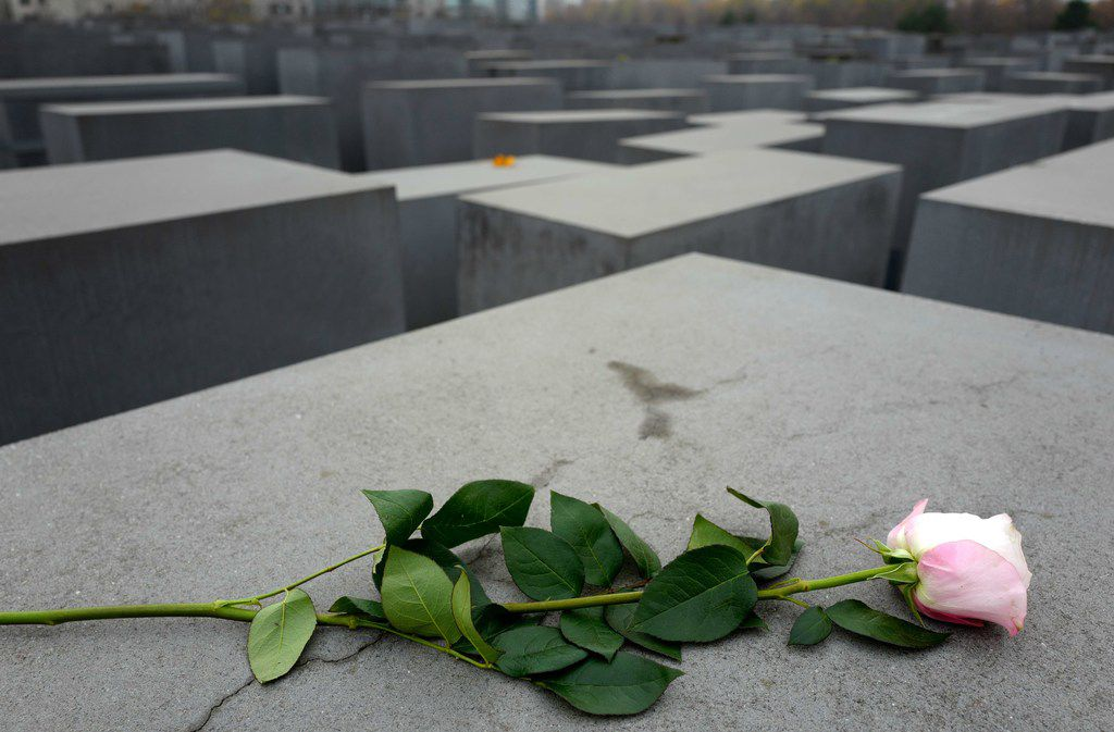 A rose is laid down on the Memorial to the Murdered Jews of Europe in Berlin on Nov. 9, 2018, the 80th anniversary of the Kristallnacht Nazi pogrom.