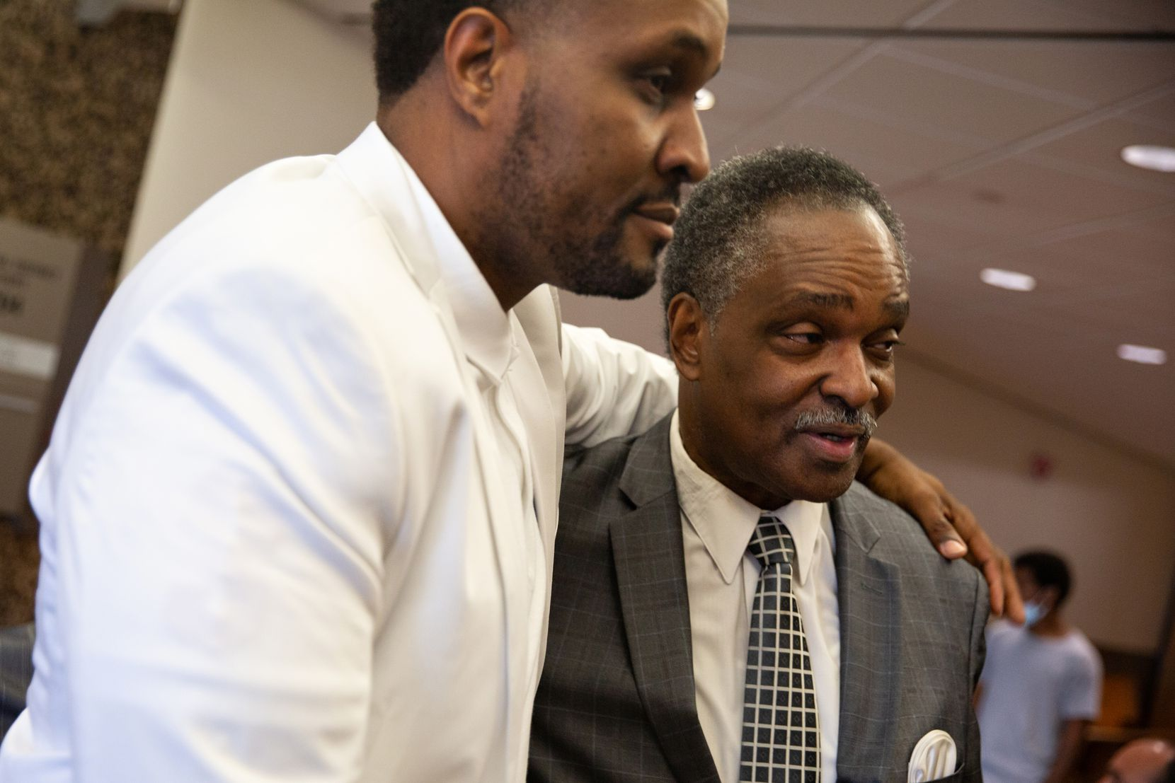 David Glover holds his brother Kenneth R. Harris Sr. after they gave their victim impact statements at the Frank Crowley Courthouse on July 26, 2021, regarding Reginal Knox's killing of their 59-year-old brother Gerald Wayne Harris. Knox faced a capital murder charge and accepted a plea deal.