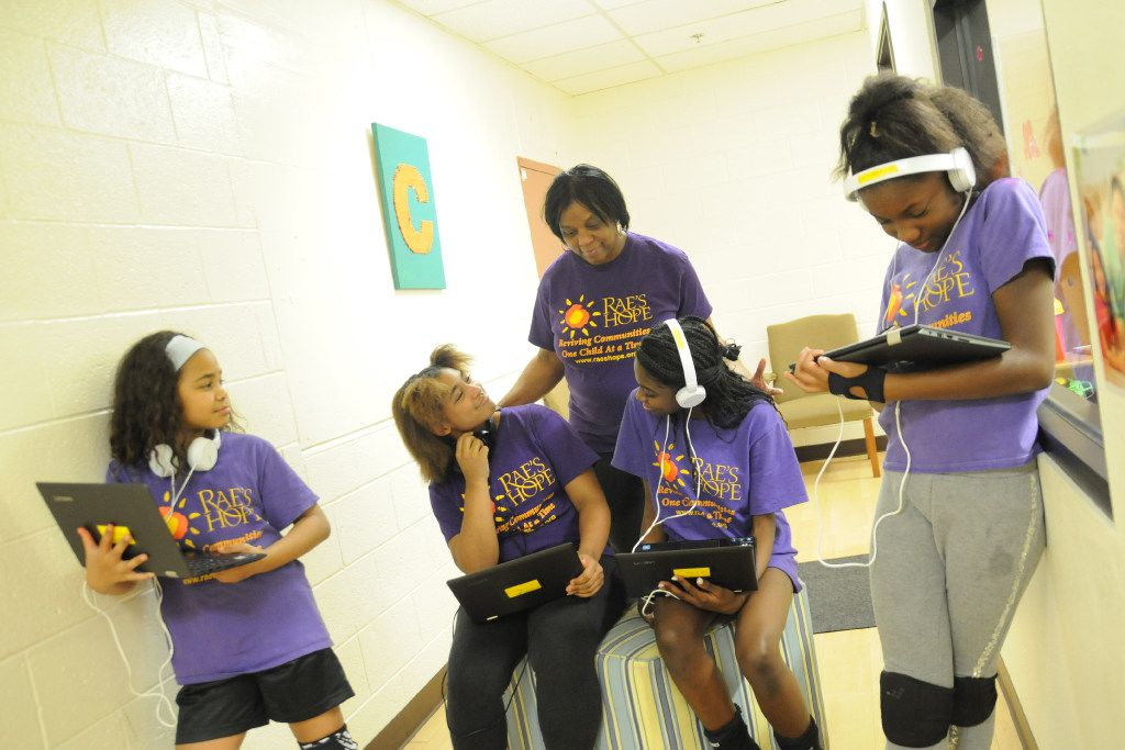 Angela Fields watches as some of the girls in Rae's Hope work with computers and tablets. Fields was the first person featured on the Dallas Heroes Project's website.