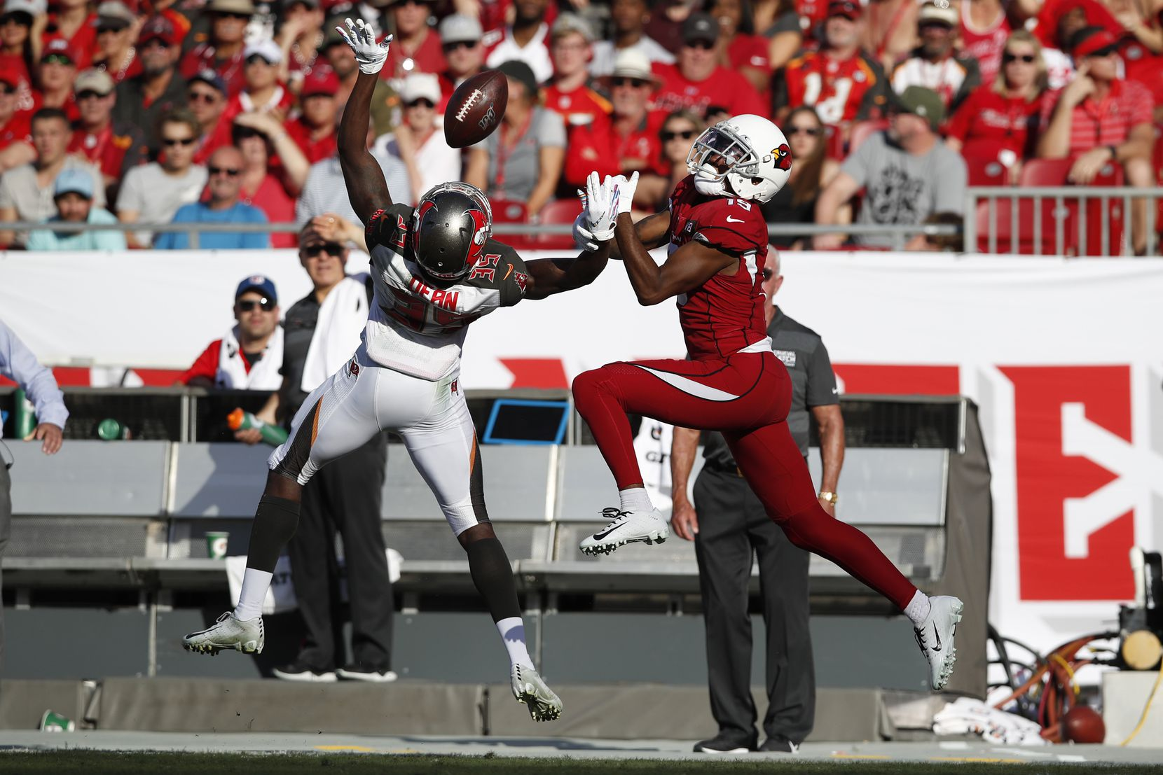 FILE - Buccaneers defensive back Jamel Dean (35) breaks up a pass intended for Cardinals wide receiver KeeSean Johnson (19) during a game on Sunday, Nov. 10, 2019, in Tampa, Fla. (Jeff Haynes/AP Images for Panini)