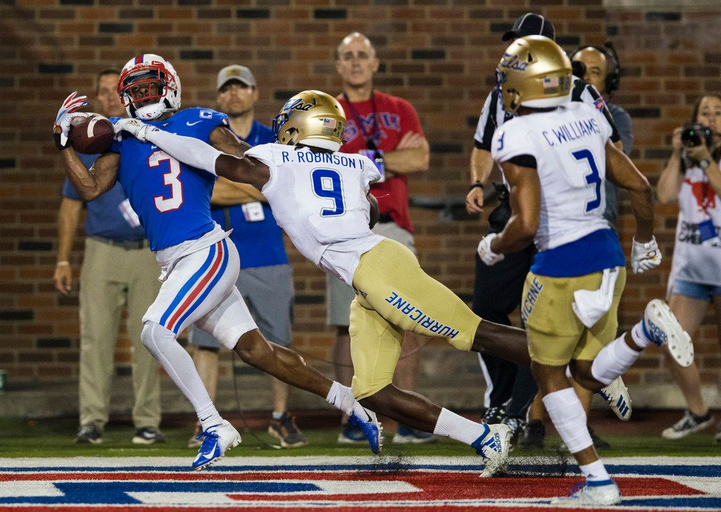 SMU Mustangs wide receiver James Proche (3) catches a pass in the end zone for a touchdown ahead of Tulsa Golden Hurricane cornerback Reggie Robinson II (9) during the fourth quarter of an NCAA football game between Tulsa and SMU on Saturday, October 5, 2019 at Ford Stadium on the SMU campus in Dallas. (Ashley Landis/The Dallas Morning News)