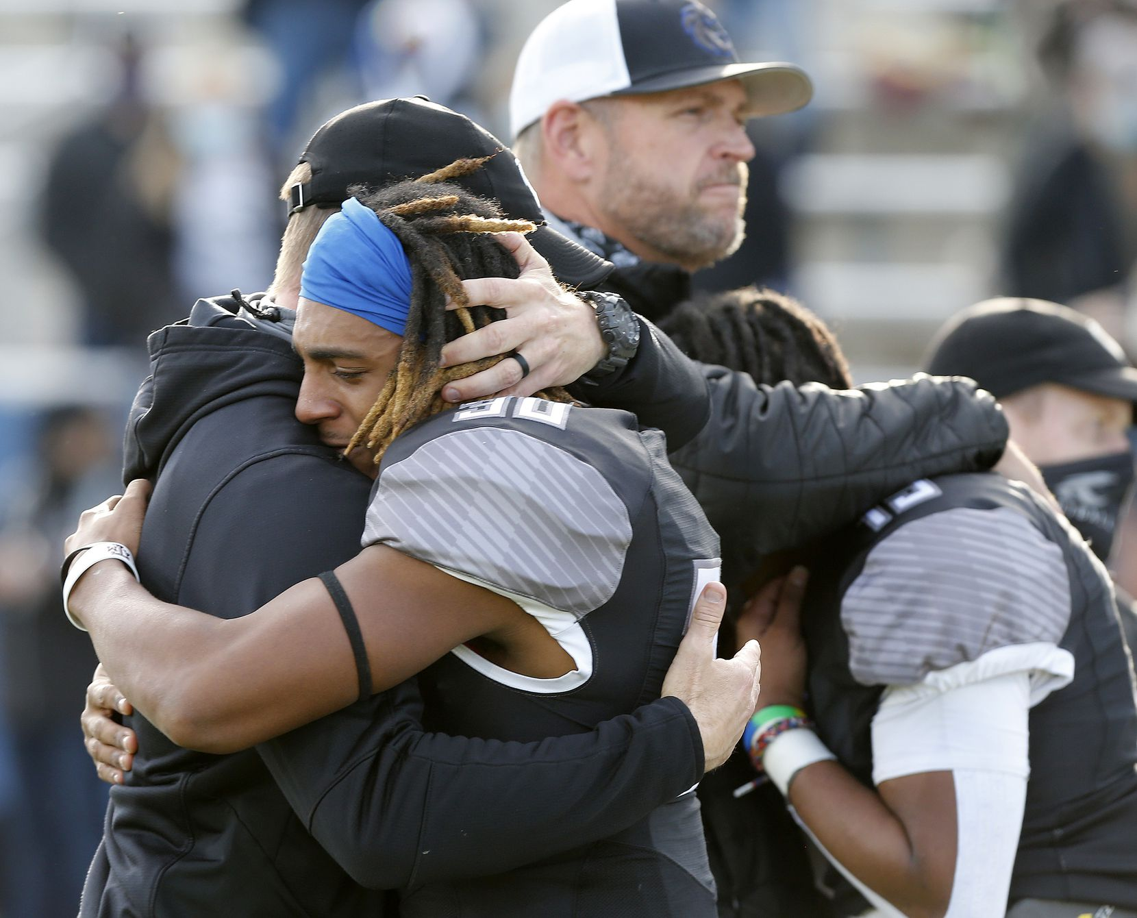 Denton Guyer High School running back Brailynn Pegues (30) is consoled by a coach after the loss as Denton Guyer High School played Cedar Hill High School in the Class 6A Division II, state semifinal at McKinney ISD Stadium in McKinney on Saturday, January 9, 2021.  (Stewart F. House/Special Contributor)