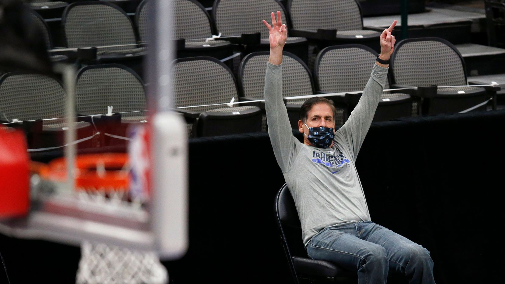 Dallas Mavericks owner Mark Cuban raises his hands for a made three-pointer against the Minnesota Timberwolves in the first quarter at the American Airlines Center in Dallas, Dec. 17, 2020.