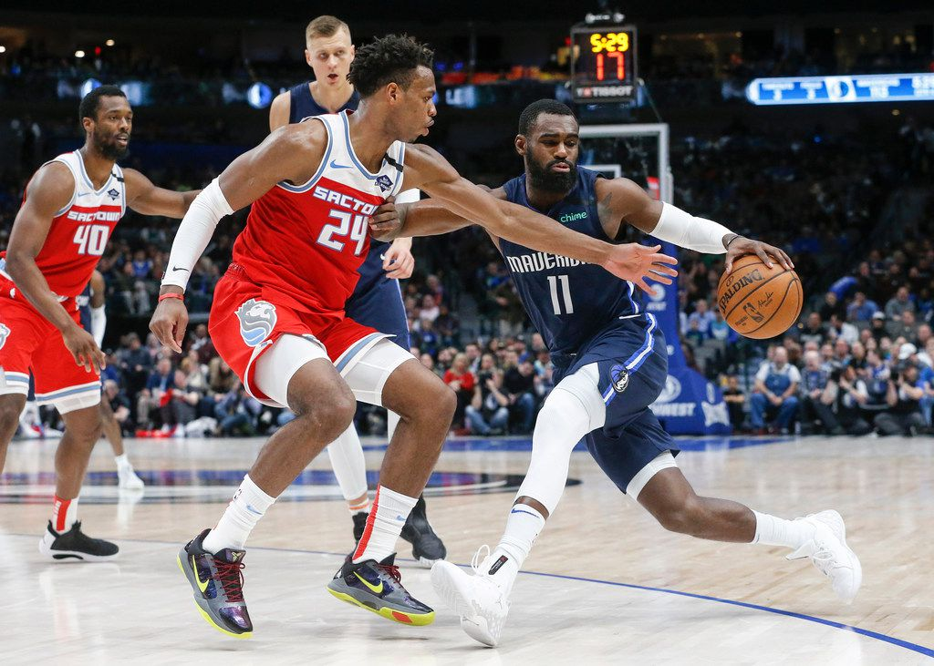 Dallas Mavericks guard Tim Hardaway Jr. (11) drives past Sacramento Kings guard Buddy Hield (24) during the second half of an NBA matchup between the Dallas Mavericks and the Sacramento Kings on Wednesday, Feb. 12, 2020 at American Airlines Center in Dallas.