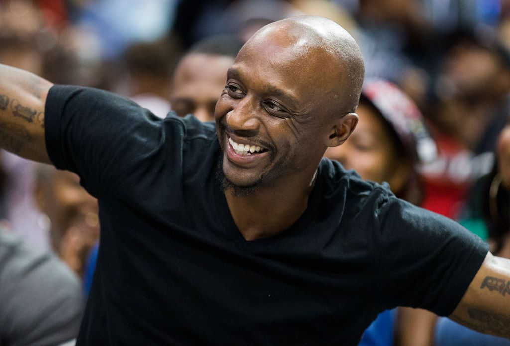 """Former Dallas Mavericks player Jason """"Jet"""" Terry smiles from his seat during a Big 3 playoff basketball game between Power and Tri State on Friday, August 17, 2018 at American Airlines Center in Dallas. Power won 51-49."""