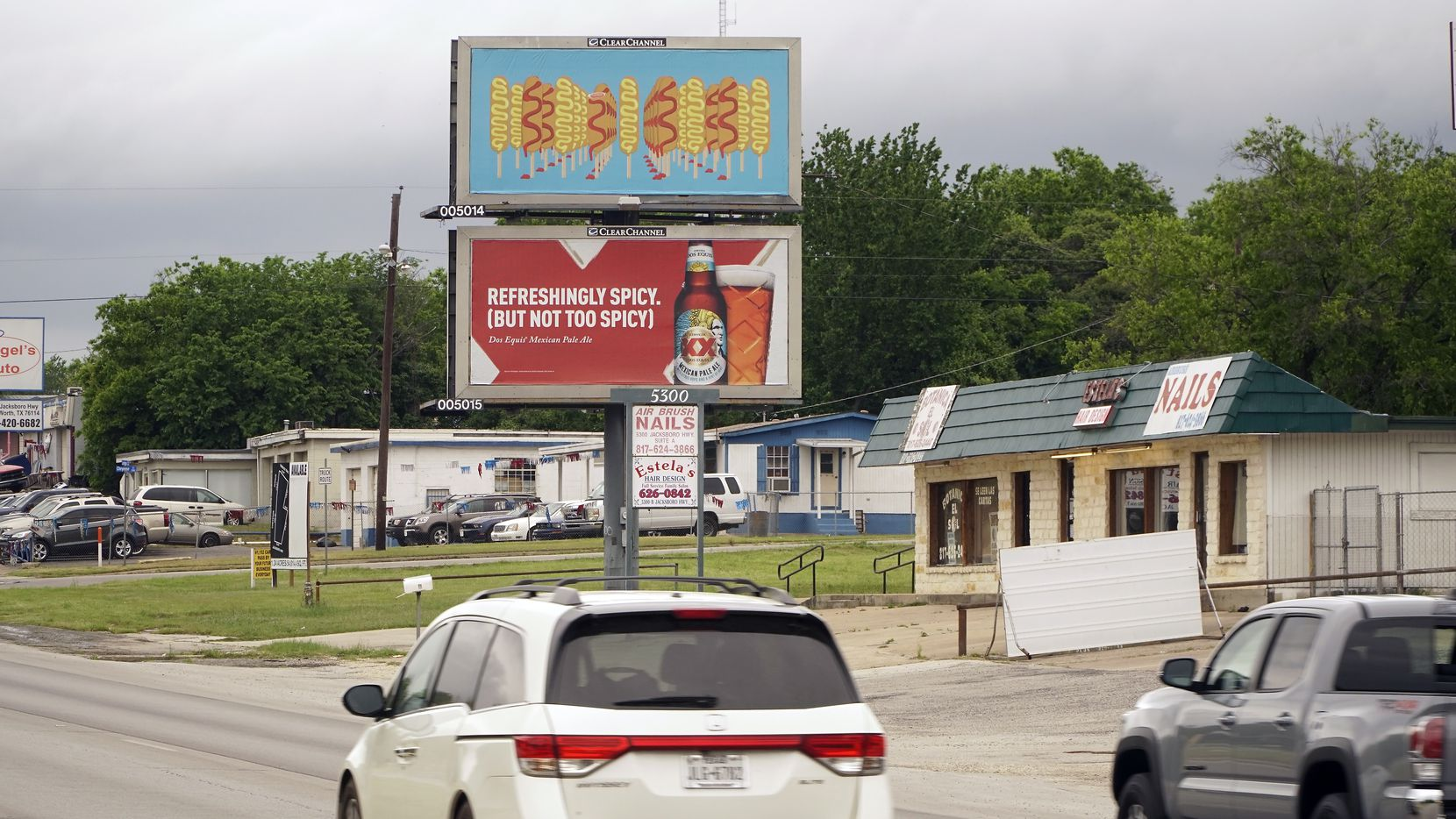 """The """"Corny Dogs"""" billboard by Katie Ritchie features rows of corn dogs extending into infinity on a powder blue background. Located at 5300 Jacksboro Highway in Fort Worth, it's part of the Modern Art Museum of Fort Worth's Modern Billings program."""