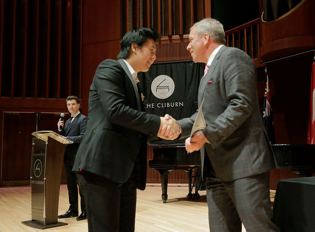 Shuan Hern Lee from Australia receives congratulations from Cliburn President and CEO Jacques Marquis after being selected as a finalist of the Cliburn International Junior Piano Competition and Festival at Caruth Auditorium on the campus of SMU in Dallas.