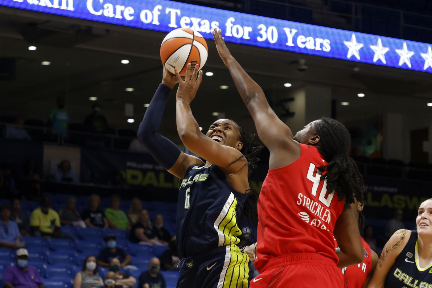 Dallas Wings forward Kayla Thornton (6)shoots in front of Atlanta Dream forward Shekinna Stricklen (40) during the first half of their WNBA basketball game in Arlington, Texas on Sept. 2, 2021. (Michael Ainsworth/Special Contributor)