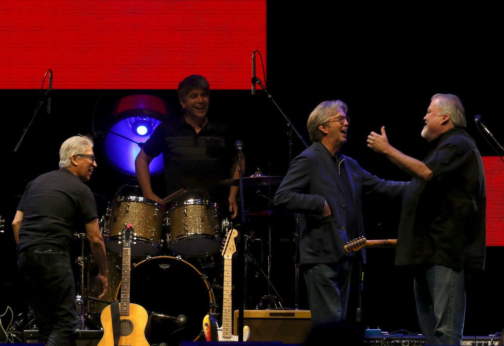 David Hidalgo (right) of Los Lobos hugs Eric Clapton after Clapton and Susan Tedeschi sat in with Los Lobos during the Crossroads Guitar Festival on Saturday, Sept. 22, 2019 at the American Airlines Center in downtown Dallas. The concert put together by Eric Clapton, which benefits his Crossroads addiction recovery center, took place over two nights with different performers each night. (Michael Hamtil/The Dallas Morning News)