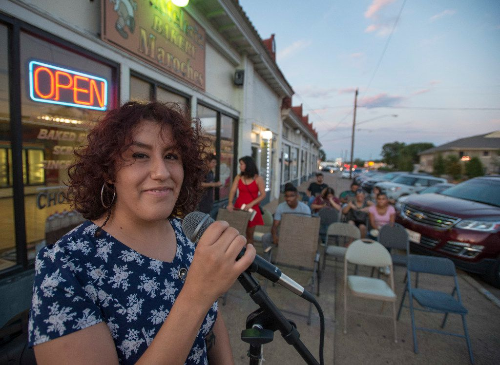 Susana Edith, founder and director of Lucha Dallas, prepares outside Maroches Bakery in the Oak Cliff neighborhood for the evening's open mike. Lucha Dallas makes an effort to work with locally owned businesses like Maroches Bakery for shows and events.