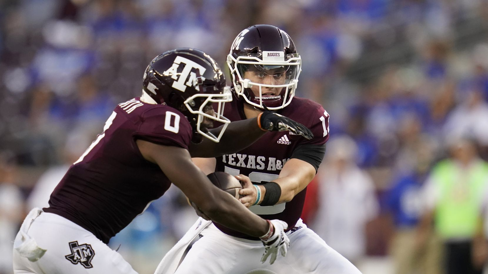 Texas A&M quarterback Haynes King (13) hands the ball off to Texas A&M wide receiver Ainias Smith (0) during the first quarter of an NCAA college football game on Saturday, Sept. 4, 2021, in College Station, Texas.