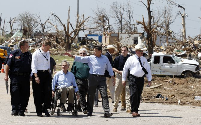 Then-Gov. Rick Perry, center, and then-Attorney General Greg Abbott -- shown inspecting damage from the 2013 Rancho Brazos tornado that killed six in Hood County -- have broadened powers of the governor's office, political scientists say.