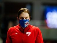 SMU's head coach Tim Jankovich watches from the sideline during the first half action of a game against East Carolina at Moody Coliseum in Dallas on Wednesday, Dec. 16, 2020.