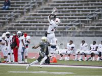 Kimball wide receiver Kyron Henderson catches a pass as South Oak Cliff defensive back Malik Muhammad defends during a high school playoff football game at Kincaide Stadium last season. Six high schools across Oak Cliff and South Dallas, including Kimball and South Oak Cliff, are getting upgrades to their athletic facilities.
