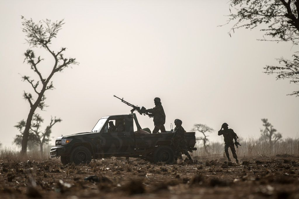 Nigerian soldiers, who train with the American forces, during an exercise near their training base at Tondibiah, on the outskirts of Niger's capital, Niamey, Feb. 13, 2018. The deaths of four American soldiers in the deserts of Niger reignited a longstanding argument over the sprawling and often opaque war being fought, under sometimes murky legal authority, around the world since the 9/11 attacks. (Finbarr O'Reilly/The New York Times)