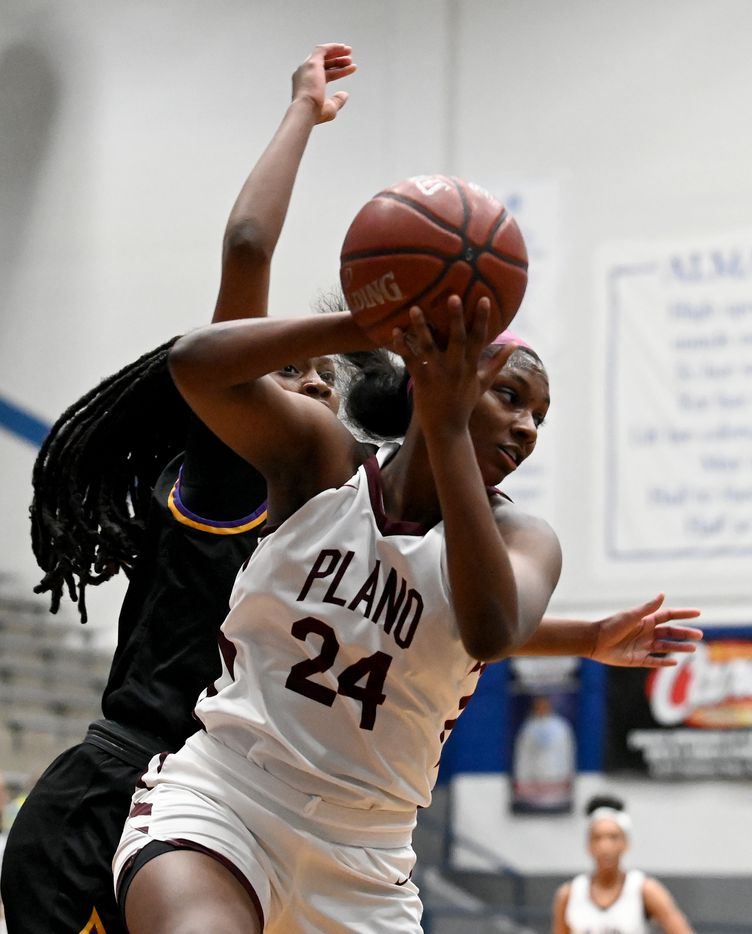 Plano's Amaya Brannon grabs a rebound in front of Richardson's Gabrielle Triplett in the second half of a Class 6A girls high school playoff basketball game between Plano vs.  Richardson, Monday, Feb. 22, 2020, in Carrollton, Texas. (Matt Strasen/Special Contributor)