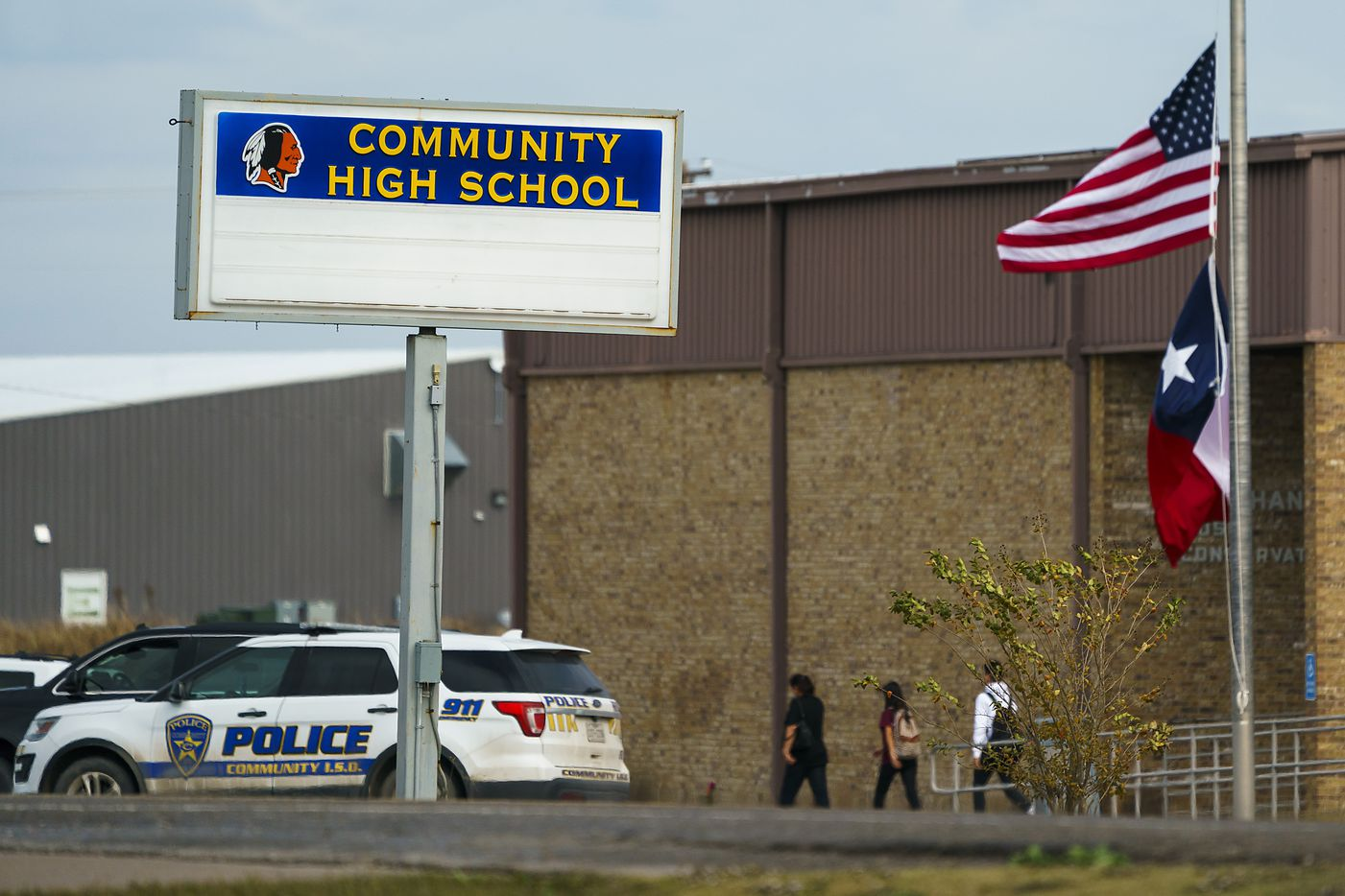 Flags fly at half staff at Community High School after four students from Community ISD in southeastern Collin County were killed in a two-vehicle crash on Wednesday, Nov. 6, 2019, in Nevada, Texas.