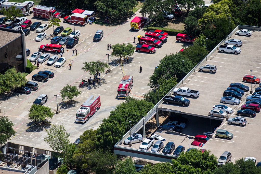 Emergency crews respond to a collapsed parking garage at 4545 Fuller Rd in Irving, Texas on Tuesday, July 31, 2018. (Ashley Landis/The Dallas Morning News)