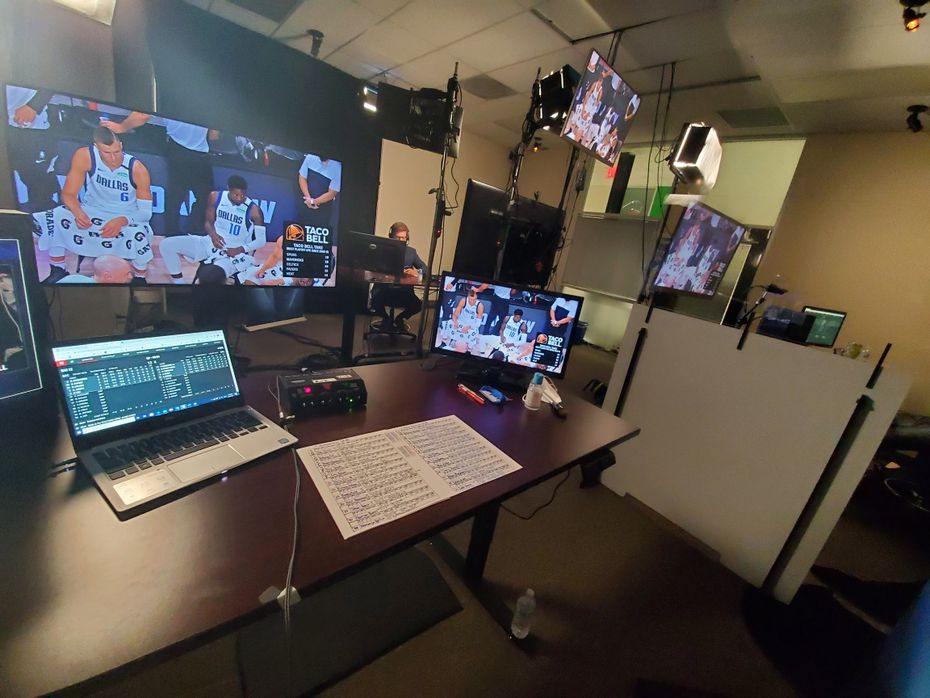 """The view from Mavericks TV play-by-play commentator Mark Followill's desk in the Fox Sports Southwest Studio. Followill and analysts Derek Harper and Jeff """"Skin"""" Wade are properly social distanced, but Plexiglas has been installed between desks because  in loud broadcast mode, I would probably say six feet is not a safe distance when you re concerned about respiratory droplets,  Followill said."""