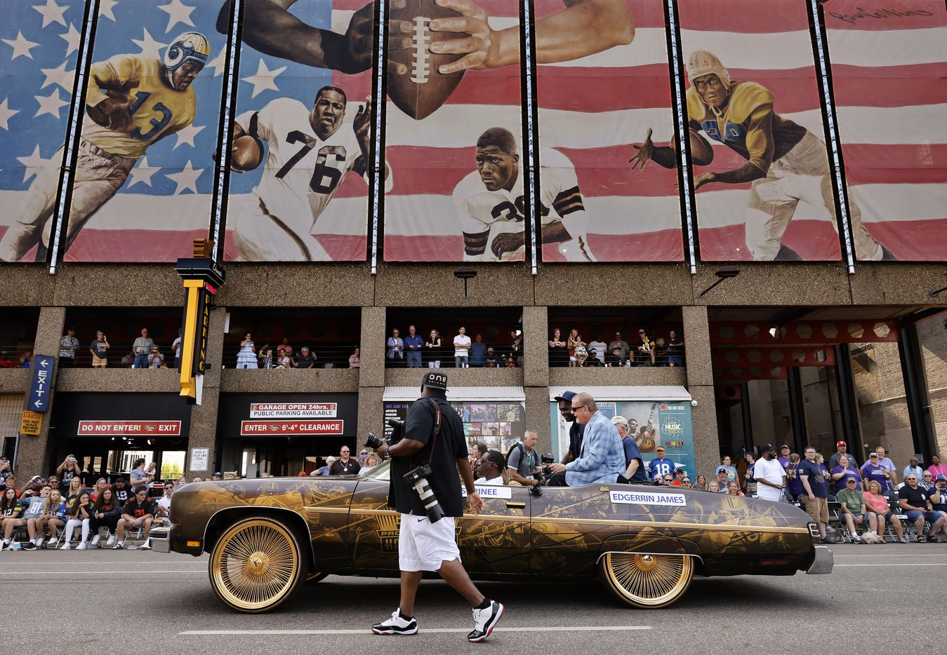 Pro Football Hall of Fame inductee Edgerrin James of the Indianapolis Colts (in black hat) rides in a decorated car during the Canton Repository Grand Parade in downtown Canton, Ohio, Saturday, August 7, 2021. The parade honored newly elected and former members of the Hall, including newcomers and former Dallas Cowboys players Cliff Harris, Drew Pearson and head coach Jimmy Johnson. (Tom Fox/The Dallas Morning News)