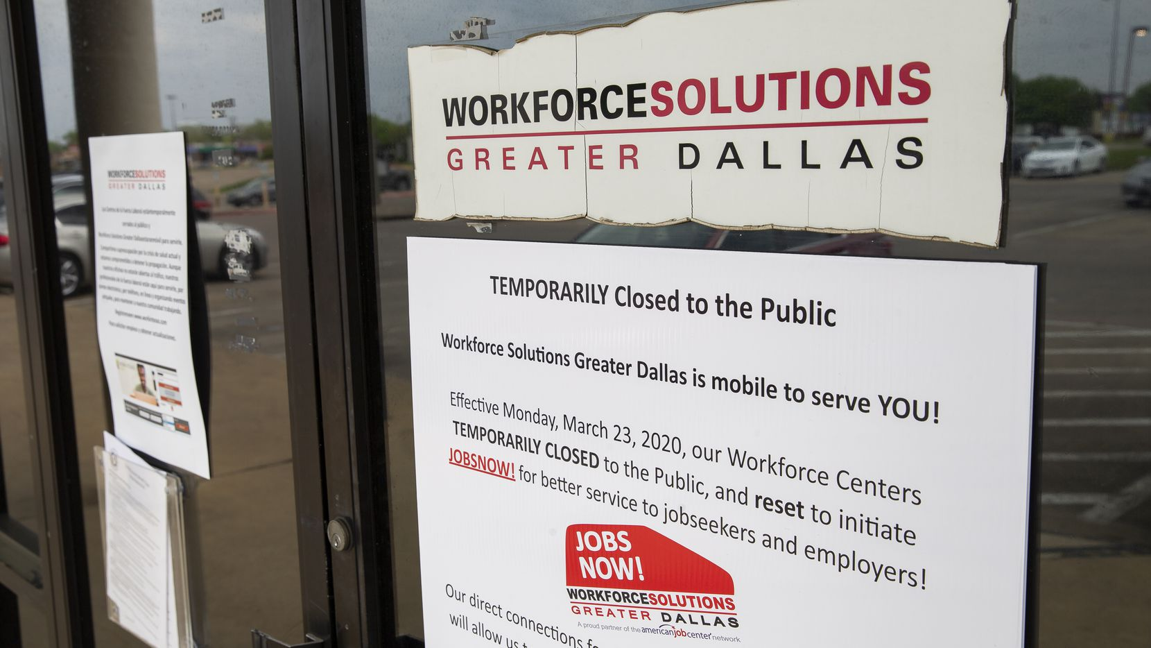 A sign announcing the temporary closure of the Workforce Solutions of Greater Dallas office in the Pleasant Grove area of Dallas on March 27, 2020.