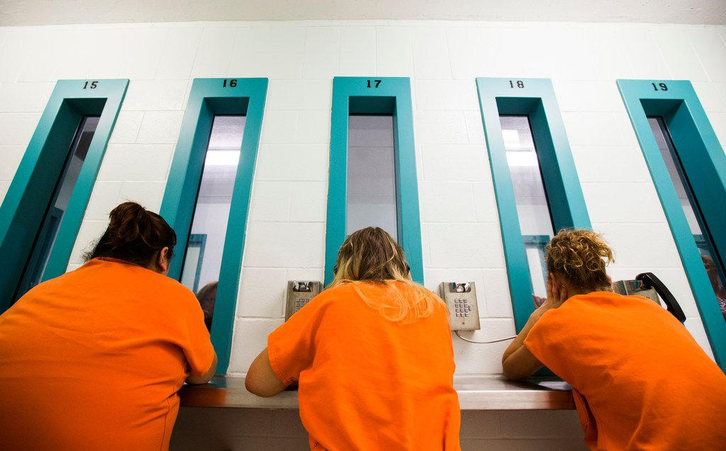 Female inmates talk to visitors through glass at Burnet County Jail in Burnet, Texas. The jail has had one of the most significant increases in female population in the state. Overall, there has been a 48 percent increase of women in jails in Texas.