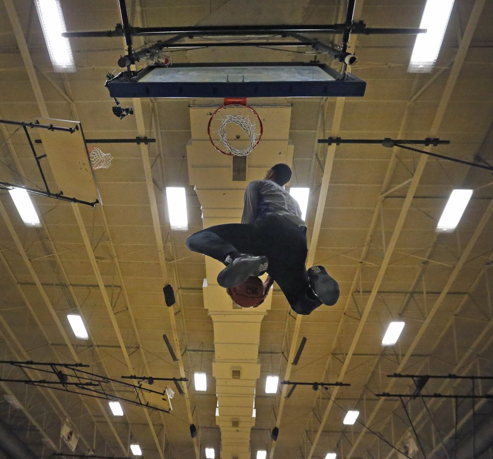 Garland Lakeview's Zhaire Smith dunks during basketball practice at Garland Lakeview Centennial High School on Feb. 23.