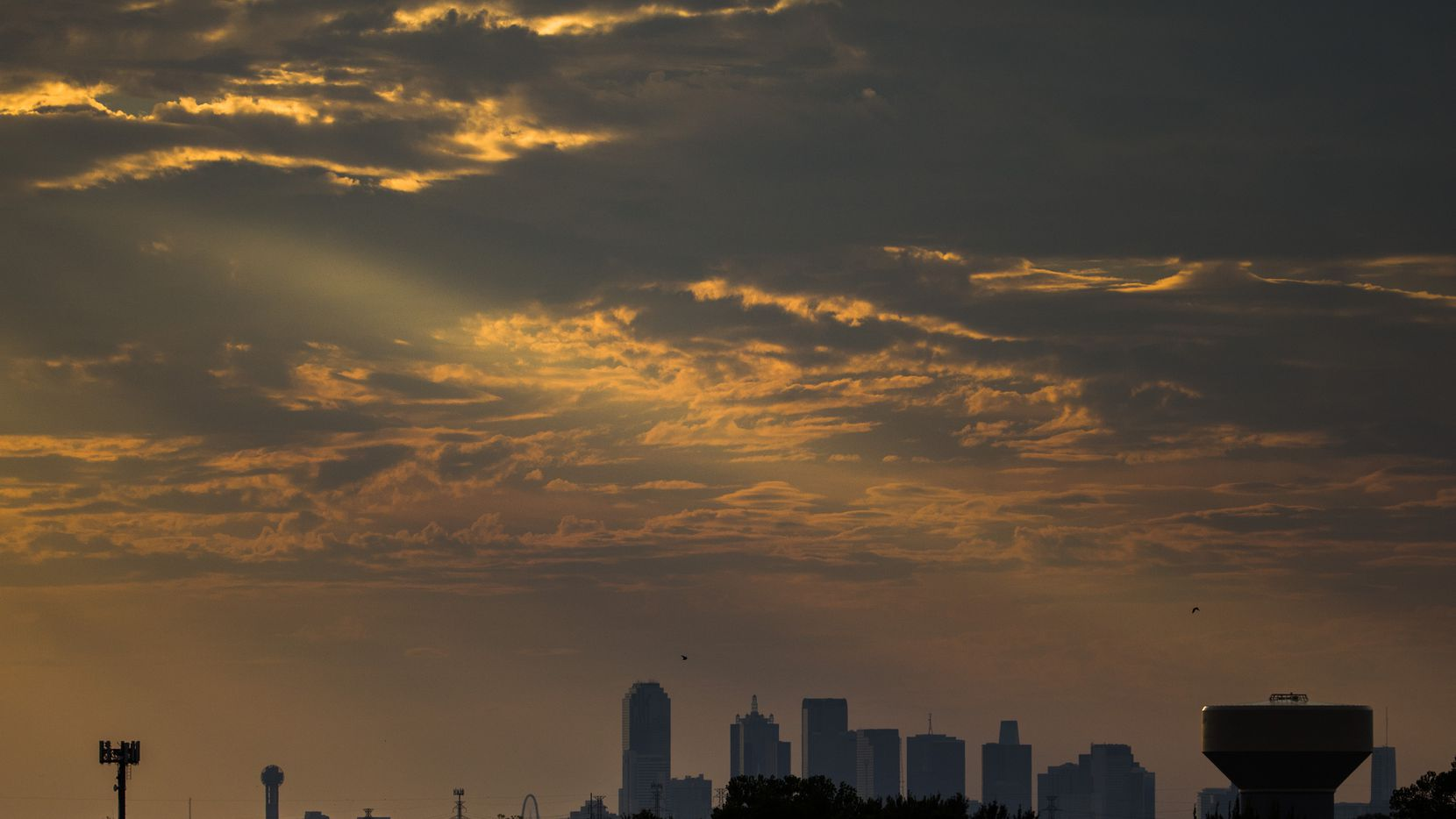 The Dallas skyline at sunset as seen from the top of Mesquite Memorial Stadium.