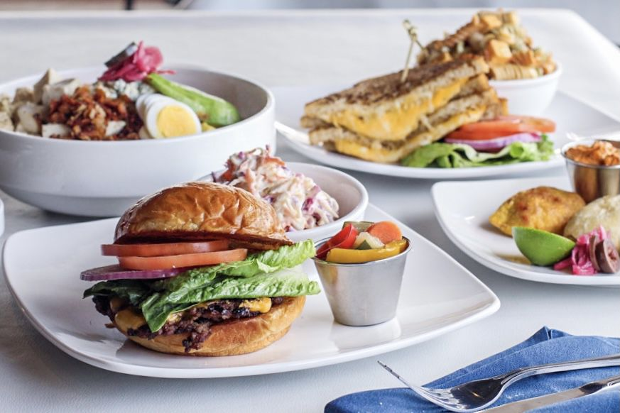BarNone's new menu items include (clockwise from top right) Jackson's grilled cheese, Chef Mike's empanadas, Jason's Double Double and the Cobb salad.