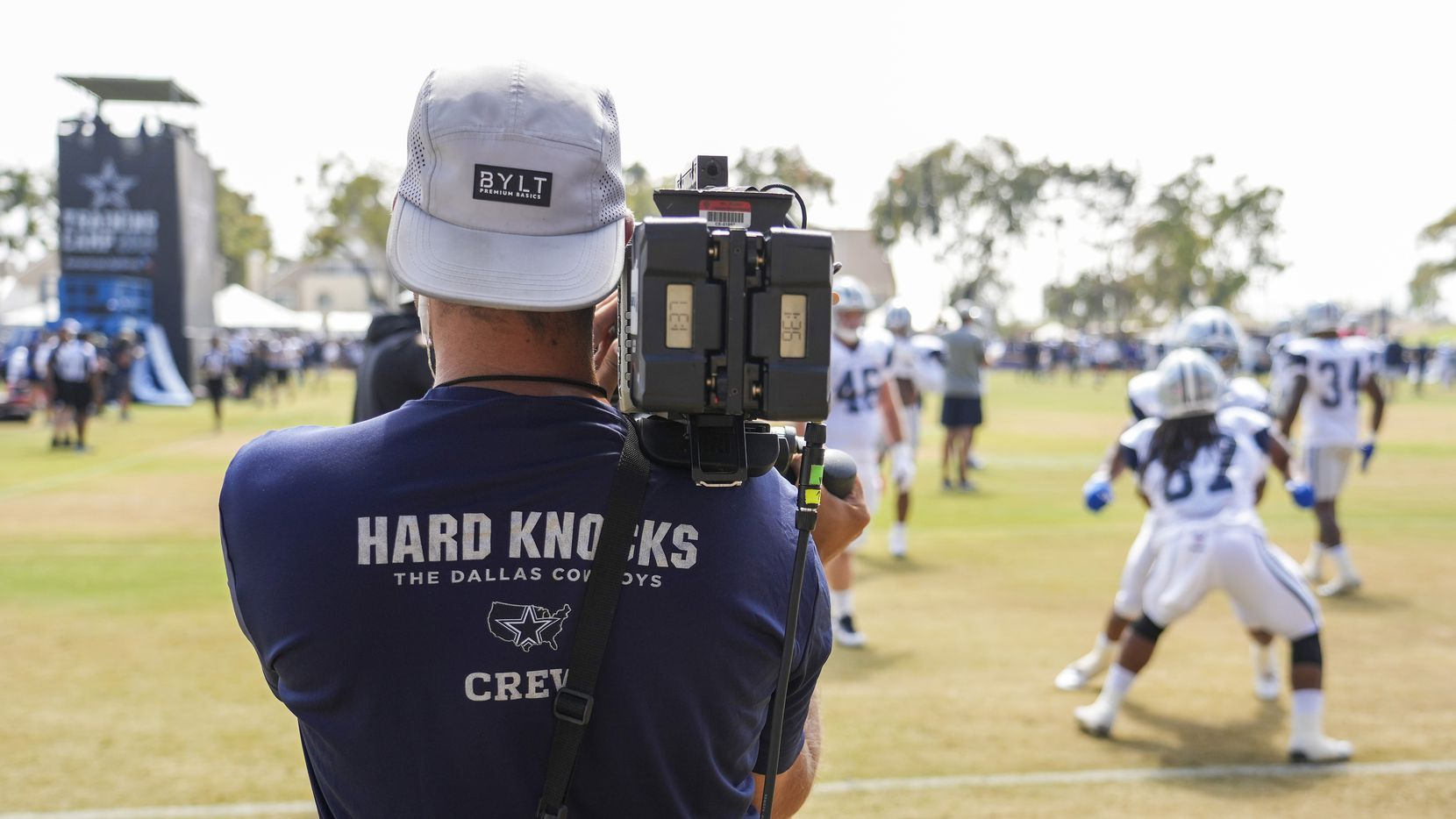 A crew from HBOs Hard Knocks captures Dallas Cowboys running back in a drill during a joint practice with the Los Angeles Rams at training camp on Saturday, Aug. 7, 2021, in Oxnard, Calif.