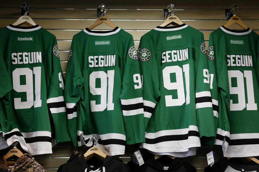 Jerseys of Dallas Stars center Tyler Seguin hang while Seguin meets fans at Rally House in Dallas Monday March 14, 2016. (Andy Jacobsohn/The Dallas Morning News)