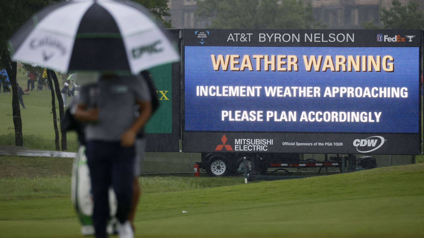Kyoung-Hoon Lee walks the green on the 9th hole as it rains during round 4 of the AT&T Byron Nelson  at TPC Craig Ranch on Saturday, May 16, 2021 in McKinney, Texas.