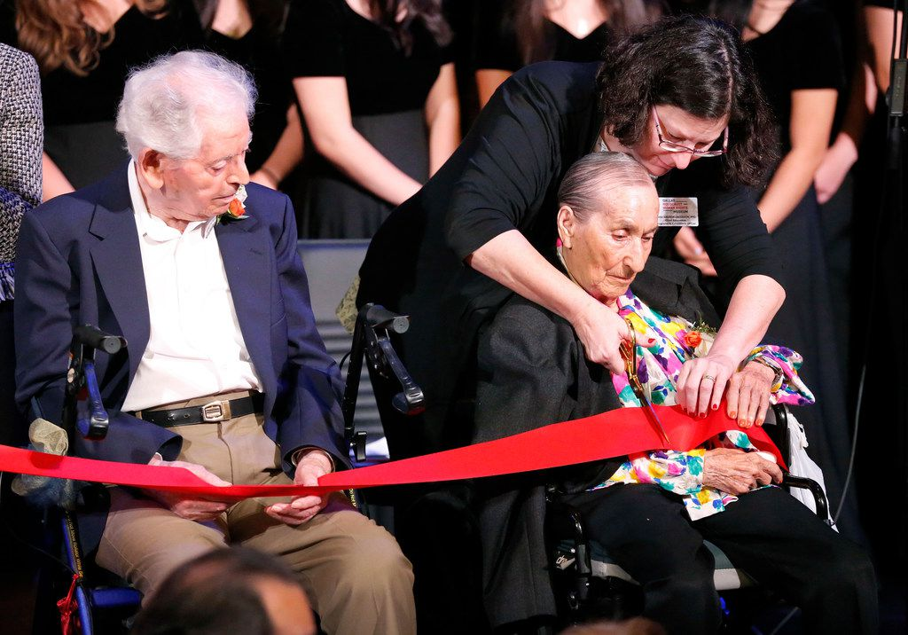 Dr. Sara Abosch Jacobson (right) helps Holocaust survivors Irma Freudenreich and Heinz Wallach participate in the ribbon-cutting ceremony for the new Dallas Holocaust and Human Rights Museum on Tuesday.