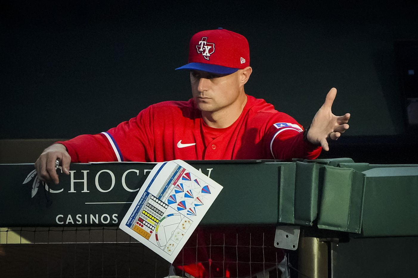 Texas Rangers first base coach Corey Ragsdale directs the team's defense during the second inning against the Minnesota Twins at Globe Life Field on Friday, June 18, 2021.