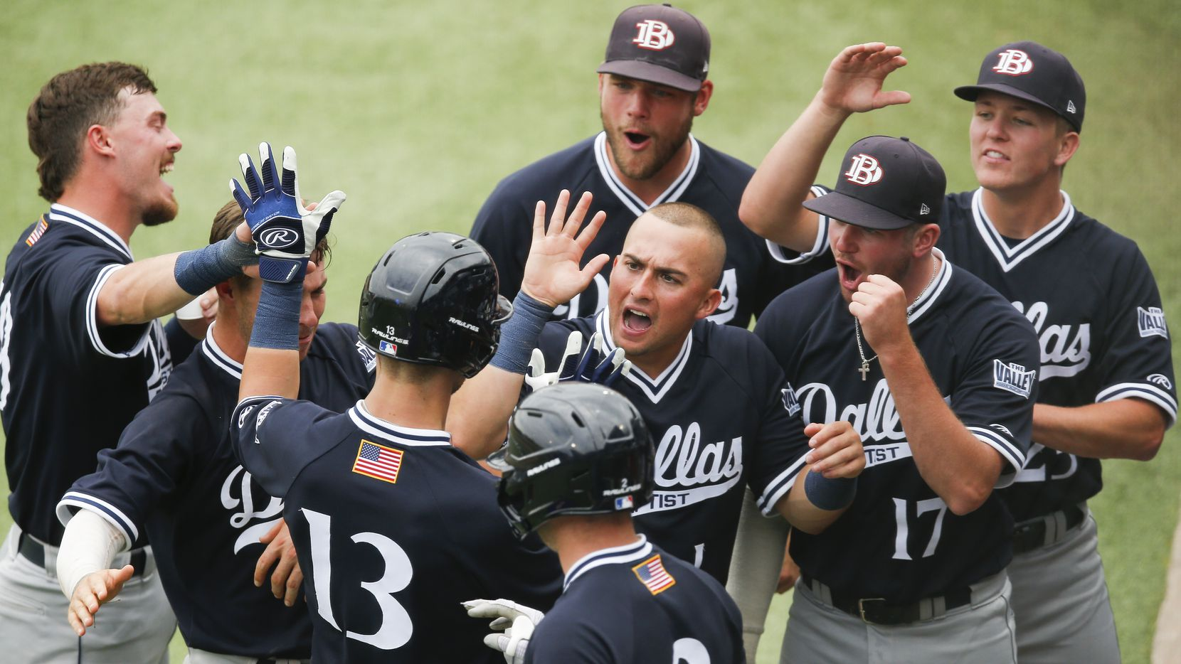 DBU's Andrew Benefield (13) is congratulated by teammates after hitting a solo home run in the fifth inning during the NCAA Fort Worth Regional baseball tournament against Oregon St. at TCU's Lupton Stadium in Fort Worth, Friday, June 4, 2021. Dallas Baptist won 6-5. (Brandon Wade/Special Contributor)