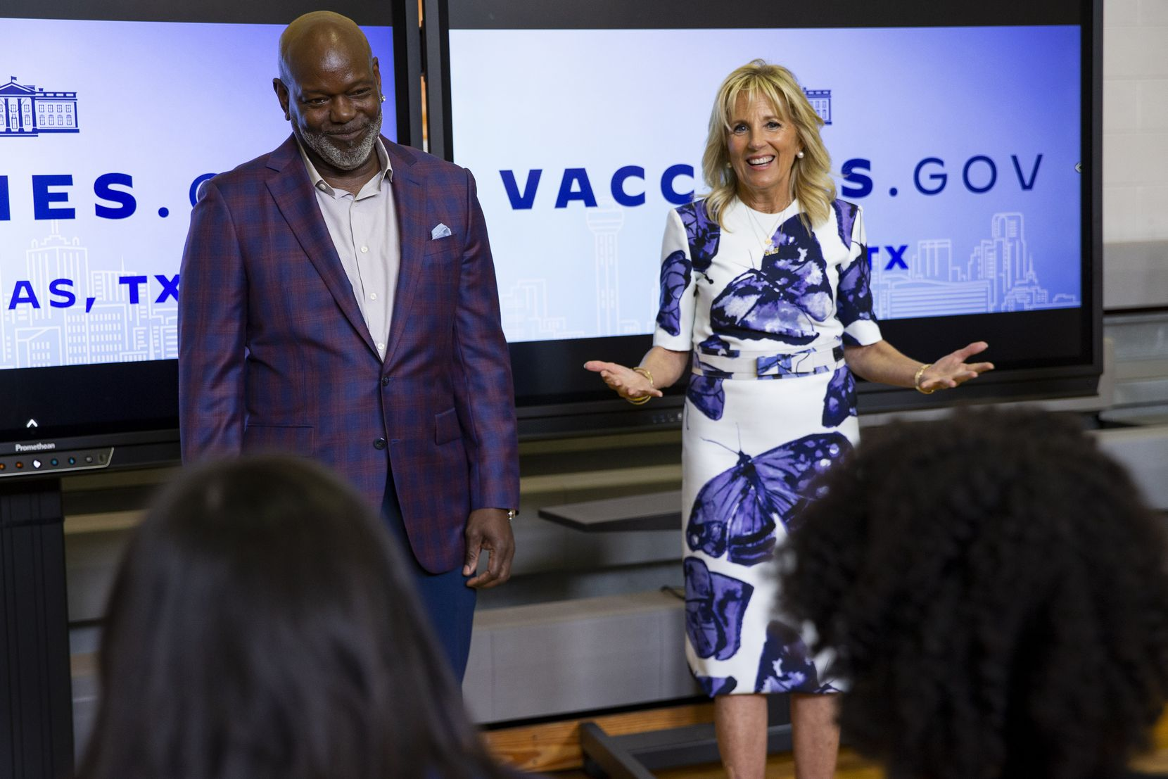 Dallas Cowboys legend Emmitt Smith (left) and First Lady Jill Biden speak to people in the observation area on Tuesday, June 29, 2021, during a tour of the vaccination site at Emmett J. Conrad High School in Dallas. (Juan Figueroa/The Dallas Morning News)