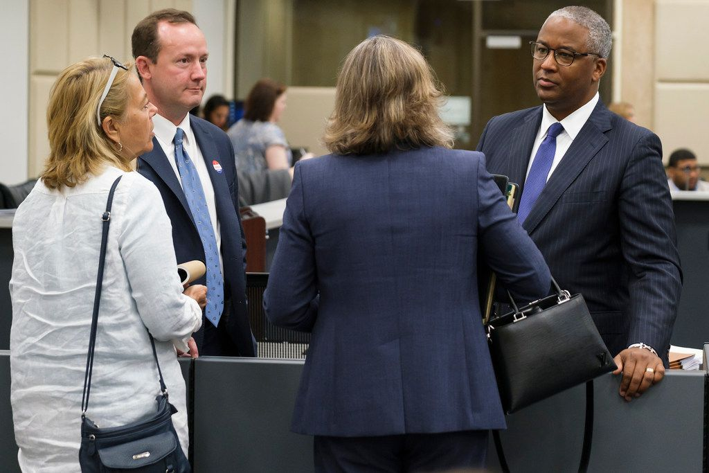 Dallas City Council member Philip Kingston talks with Sara Wick (left),  Melissa Kingston and his attorney Victor Vital after being cleared by the Ethics Advisory Commission during a hearing at Dallas City Hall.