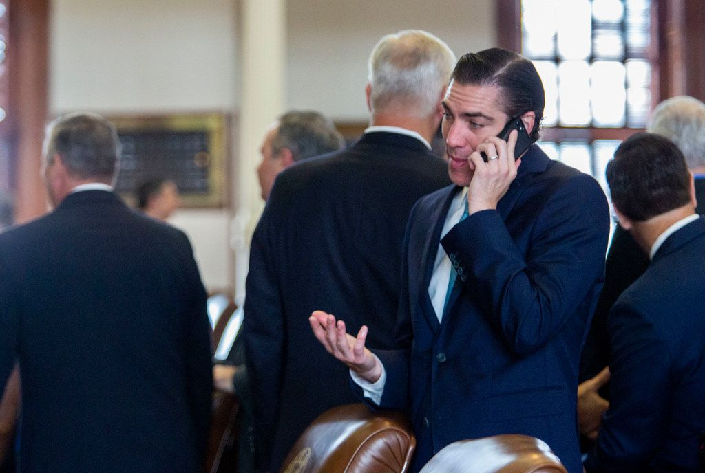 State Rep. Morgan Meyer chats on the phone while on the House floor just before Sine Die at the State Capitol of Texas on May 27, 2019 in Austin, Texas.