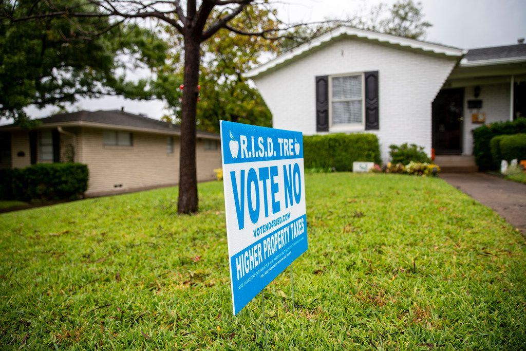 A sign opposing the proposed 13-cent tax rate increase on the November ballot sits in front of Tony Harkleroad's home in Richardson on Oct. 25.