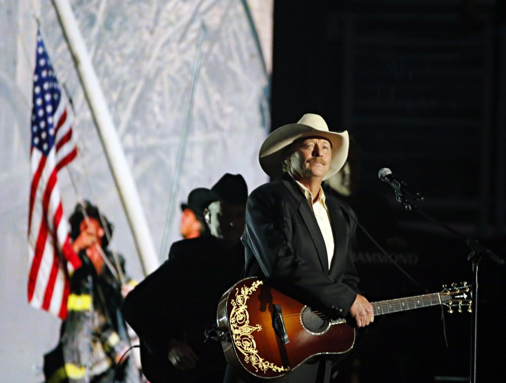 Alan Jackson stands in front of a projected image from the 9/11Terrorist Attacks as he performs during the 2015 Academy of Country Music Awards Sunday, April 19, 2015 at AT&T Stadium in Arlington, Texas.