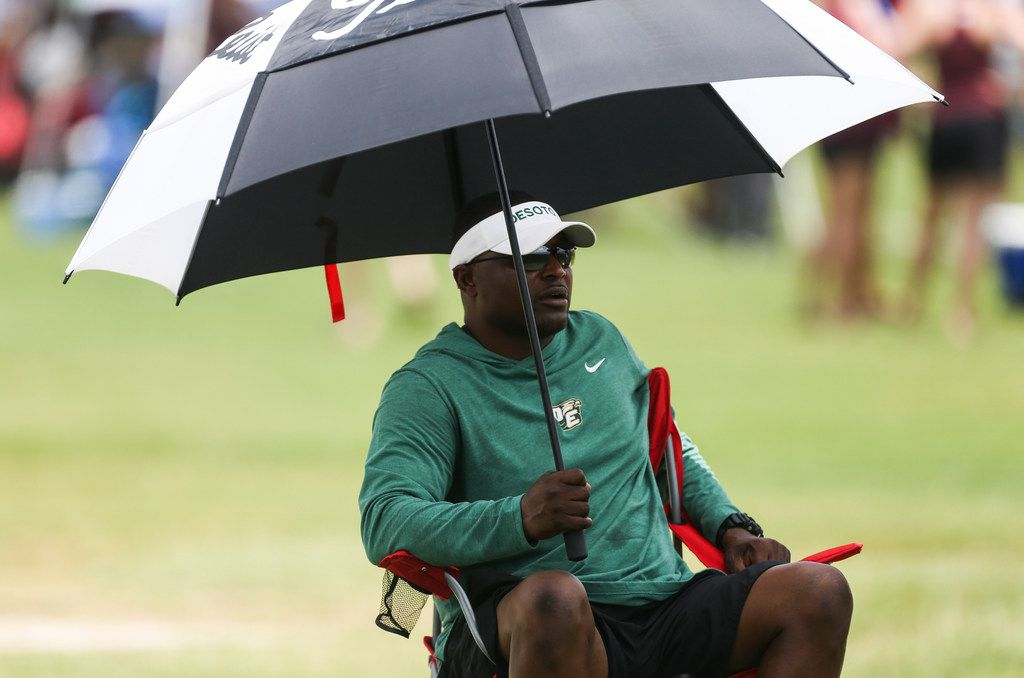 DeSoto coach Claude Mathis sits on the sidelines during the 2019 Texas 7on7 Championship football tournament on Friday, June 28, 2019 at Veterans Park and Athletic Complex in College Station, Texas. (Ryan Michalesko/The Dallas Morning News)