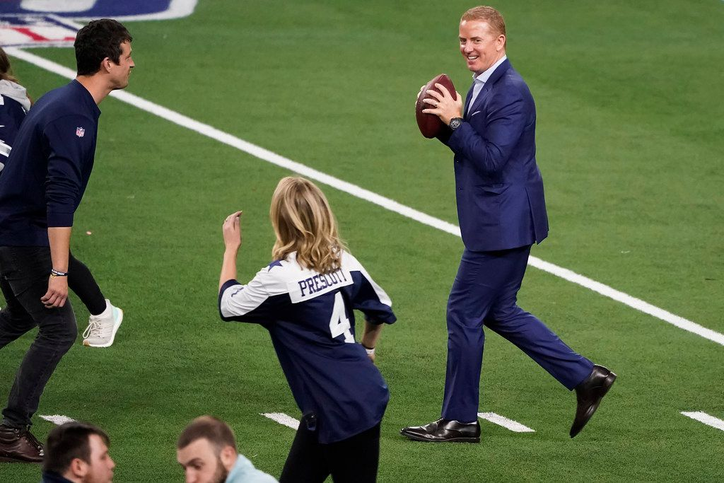 Hours after the end of the Dallas Cowboys final game of the season, a 47-16 victory over the Washington Redskins to end the season with a record of 8-8, head coach Jason Garrett tosses a football on the field with friends and family after an NFL football game at AT&T Stadium on Sunday, Dec. 29, 2019, in Arlington.