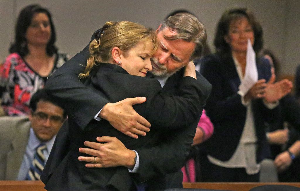 Former Judge Suzanne Wooten embraces her husband Wes Wayland after her 2011 convictions are vacated during proceedings in the 416th District Court in McKinney, Texas, on Wednesday, May 24, 2017.
