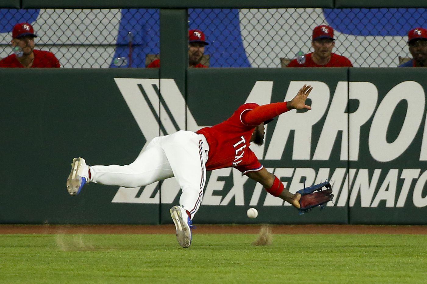 Texas Rangers center fielder Adolis Garcia (53) misplays the ball during the third inning against the Kansas City Royals at Globe Life Field on Friday, June 25, 2021, in Arlington. (Elias Valverde II/The Dallas Morning News)